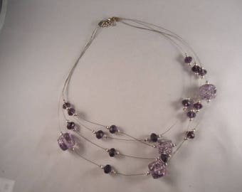 Silver cable necklace 4 rows and its unique purple beads