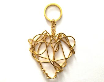 Gold colored squiggle heart charm bag charm key ring / Eve Damon