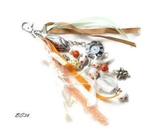 bag charm orange glass beads and shows BS38