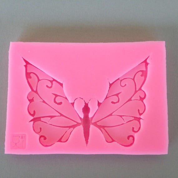 Beautiful butterfly food safe Silicone mold perfect for fondant, polymer clay, chocolates, candy, soap resin work and much more.