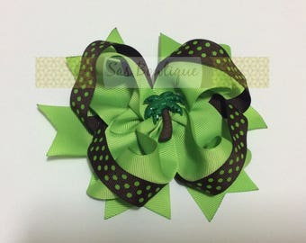 Green and brown palm tree bow