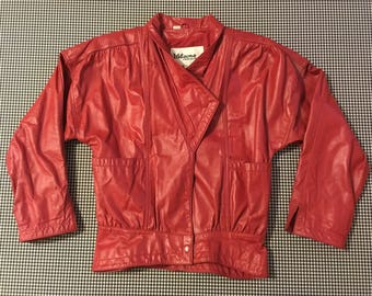 1980's, red leather jacket, with wide, front to side, to back, pockets, Women's size Small