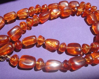 Miriam Haskell signed long necklace with big amber beads,