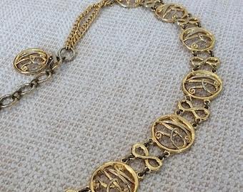 20% SUMMER SALE Rare vintage Nina Ricci chain link NR signature belt and necklace