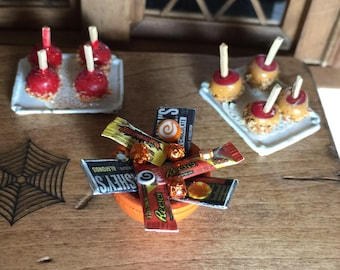 Dollhouse Table Laden with Halloween Candy and Candy Apples and Carmel Apples for Trick or Treaters in One Inch Scale