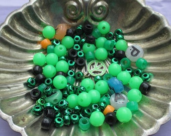 Lot Of Salvaged Mainly Green Colored Plastic Beads Plus Peace Sign Charm