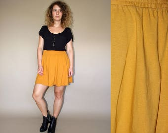 90's vintage women's yelow high waisted elastic waist cotton mini skirt