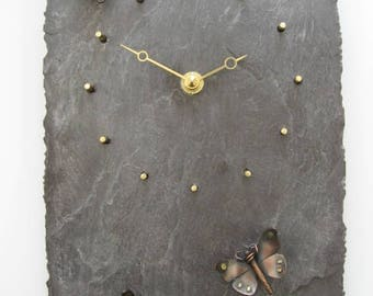 Butterfly wall clock in copper and brass mounted on reclaimed Welsh slate