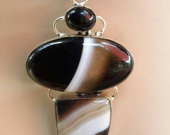 A Bold Batswana Agate Pendant in Colors of Black, Caramel & White