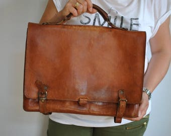 Vintage LEATHER BRIEFCASE with advance patina .......(303)