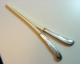 An antique glove stretcher with silver handles