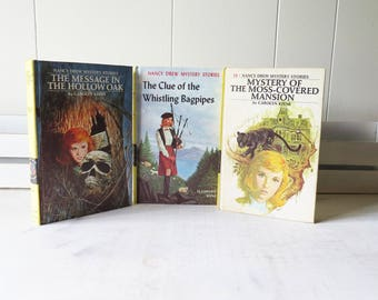 3 Vintage Nancy Drew Books- Clue of the Whistling Bagpipes (1964), Mystery of the Moss Covered Mansion (1971) Message in the Hollow Oak 1972
