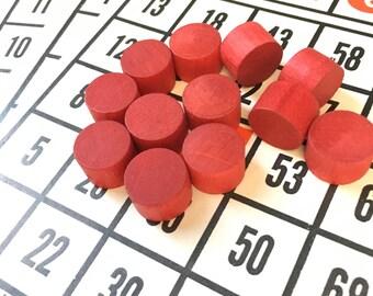 Vintage bingo cards and wooden pieces
