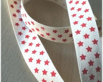 "decorative Ribbon: ""red stars"" on an ecru background"