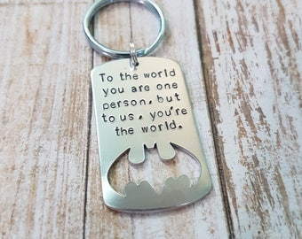 To the world you are one person but to us you're the world hand stamped bat keychain