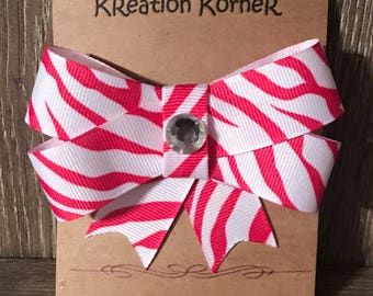 Pink and white zebra print bow