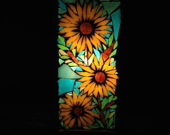 To order. Light mosaic stained glass depicting sunflowers on the way for the holidays. Sold.