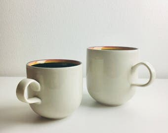 "A pair of vintage Arabia Finland coffee cup& tea cup named ""Reimari"" by Inkeri Leivo, 1980s,  Made in Finland"