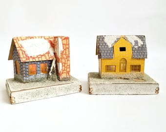 Pair of Vintage Putz Houses for Christmas Winter Decor. One Yellow, One Blue House, Glitter Snow and Raised Bases.