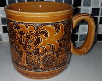 Churchill England embossed floral mug.