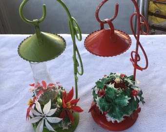 Vintage red and green Christmas hurricane oil lamps with smoke bells