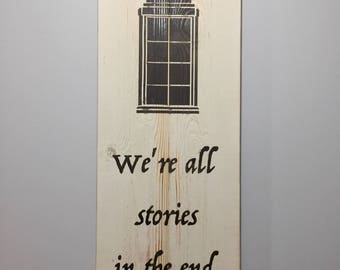"""Doctor Who Inspired Minimalist Barnwood Sign. """"We're all stories in the end."""" (white background)"""
