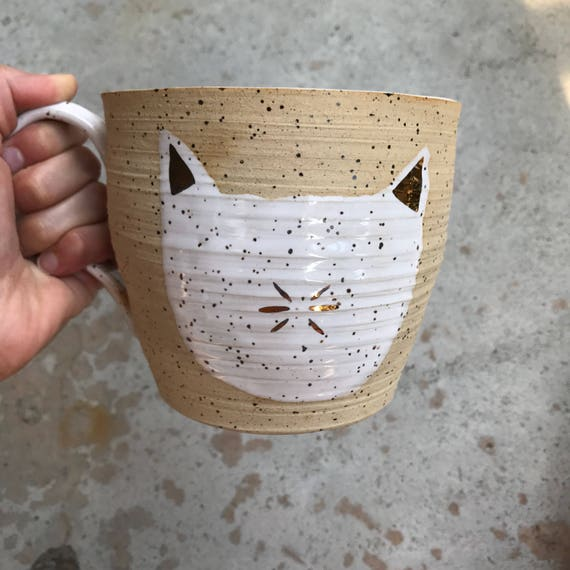 Massive gold and ceramic cat mug