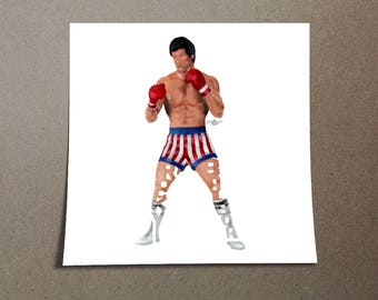 """Rocky Balboa Poster Typography Design from the movie Rocky with his name, """"Rocky Balboa"""" in his Boxing uniform on a wall poster"""