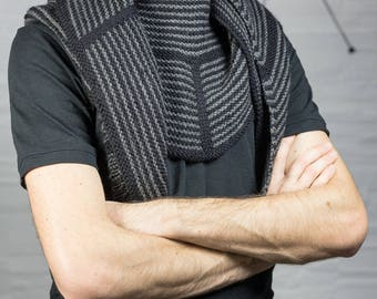 Black man and hand knitted grey scarf