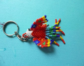 Two hand beaded parrot key chains made in Guatemala.