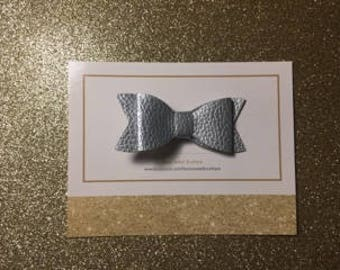 Silver leather bow clip