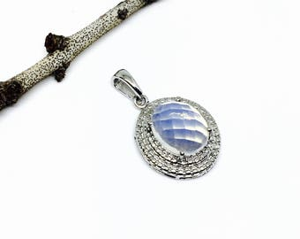 Blue Opalite pendant, necklaces set in sterling silver 925. Length - 1 inch long. Natural opalite stone.