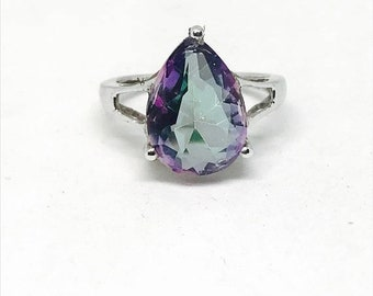 10% Mystic topaz ring set in sterling silver (92.5). Size 5 1/2, 7 and 8. Genuine teardrop mystic topaz stone.