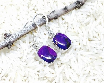 10% Mojave purple Copper turquoise earrings set in sterling silver 92.5. Perfectly matched stones. Length- 1/2 inch