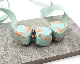 Mint and copper chunky statement necklace. Large geometric beads with copper leaf on matching ribbon. Handmade by GRAYJAY