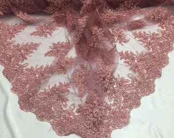 Uniquely designed beaded mesh Lace Fabric Bridal Wedding dusty rose. Sold By Yard