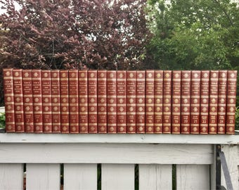 Complete set Funk and Wagnalls Encyclopedias circa 1973, 25 books in total hars covers and gold lettering