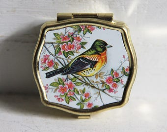 Vintage pill box with bird on a flower branch.