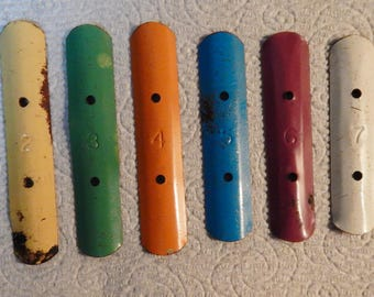 Two sets of vintage children's xylophone keys, 16 total