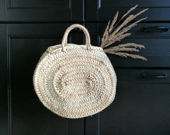 Oval round basket with palm leaves, round basket, basket bag.
