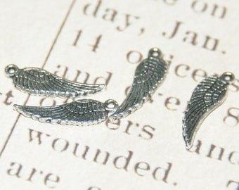 6 small silver-plated 17x5mm wing charms