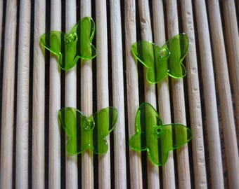 Transparent green plastic butterfly, sold in sets of 4.