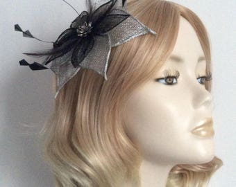 METALLIC SILVER and BLACK Fascinator, Sinamay petals, with Black trimmings, rhinestone flower, on comb