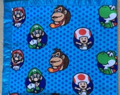 Nintendo characters fleece blanket - blue background with Mario, Luigi, Yoshi, Toad, Donkey Kong, and Diddy Kong - fabric by the yard