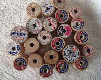 Twenty-three empty wood thread spools   Coat and Clarks   Talon   J  and P  Coats  
