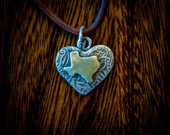 Gold and silver Texas pendant, textured heart