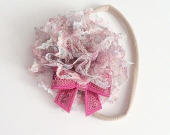 Vintage pink flower headband on a nylon headband with a hot pink bow.