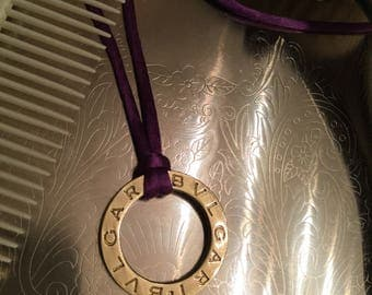 Vintage bvlgari circle pendant on a purple cord