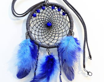 Necklace cord with a dream catcher with feathers