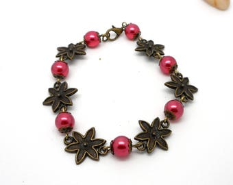 Bronze flowers and red beads